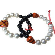 Two Bracelets for Halloween Happening: Pearls, blackstone, and Spider and corn kernel lampwork beads: Origianl handcrafted