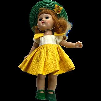 Vintage Ginny doll: MLW (Molded eyelash walker): Pat. No. 2687594: Sleepy eyes: Blue eye-black pupil: 1955-1957: yellow white dress: green hat and shoes: