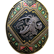 "Vintage: Damascene: Toledo Spain: inlay oval brooch.: Moorish 2"" across: Gold black red and green"