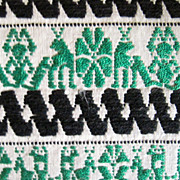 Vintage: Dresser Scarf, Green and black embroidery on a fine cotton background,  Stylized green figures, black zigzag pattern 50s