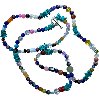 Necklace: Long 38 inches: Many different glass beads: a variety of stones: Glass. turquoise:  Hand crafted:  Unique