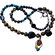 "Necklace: Artisan:  Necklace:  Millifiori. Blackstone: Turquoise: Tiger eye beads: Sterling pendant with Amber, Turquoise, Yellow Jasper: 24""  antique toggle;"