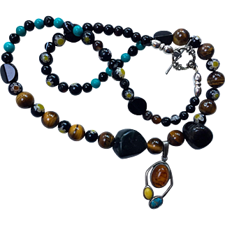 """Necklace: Artisan:  Necklace:  Millifiori. Blackstone: Turquoise: Tiger eye beads: Sterling pendant with Amber, Turquoise, Yellow Jasper: 24""""  antique toggle;"""