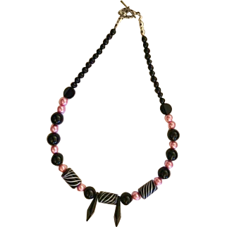 Artisan necklace: black jet beads: pink pearls: black diamond jet focals: 18 inches: toggle