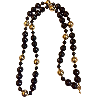 Vintage necklace: Black shiny and Gold tone 3/8 inch beads.  30 inches