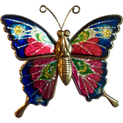 Vintage Pin: Dazzling colored butterfly: Enameled wings: brass body and antennae: 2.5 x 1.75 inches.