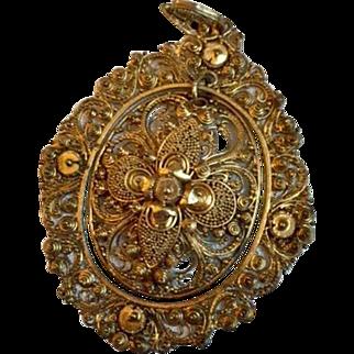 Vintage: large brass pendant: swinging center: stamped and filigree designs