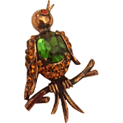 Vintage Weiss copper bird pin: green Jelly belly rhinestone: orange rhinestone wings: hallmarked