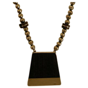 Allen Kee, Designer, Ironwood and Sterling Silver Pendant circa 1950's