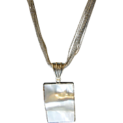 Mabé Pearl Pendant with contoured Bezel, 12-strand fine silver necklace