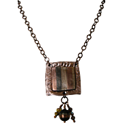 Mixed Metals Pendant: Blended stripes of copper, bronze and steel