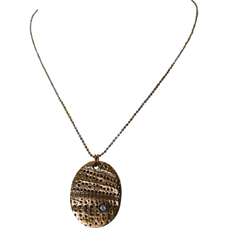 Mixed metals series: Bronze textured pendant with pavé cz