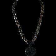 Medieval man-piece, wrought iron pendant, Kumihimo necklace