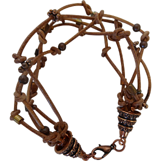 Multi leather cord bracelet with copper cones and clasp