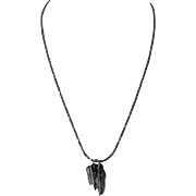 Broomstick casting Pendant, with shiny faceted silver chain.