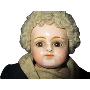 Antique closed mouth composition doll