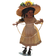 Sassy black bisque doll by Jude Kapron
