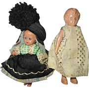 Two adorable small dolls