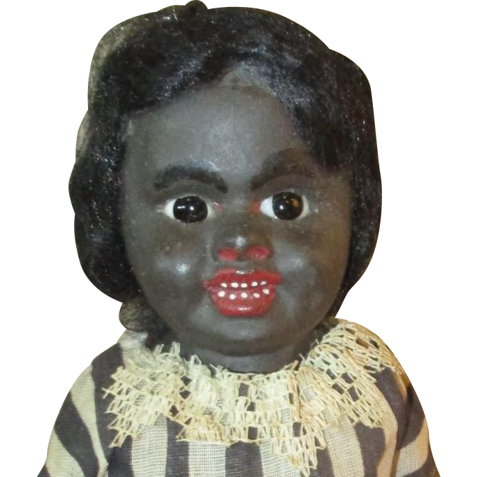 Adorable Black paper mach doll