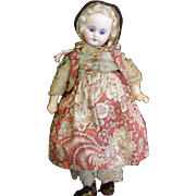 Adorable cabinet size bisque doll