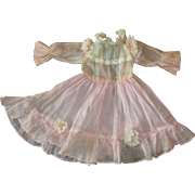 Adorable pink dress with rosettes