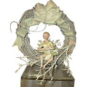 Beautiful bisque fairy doll on icy wreath