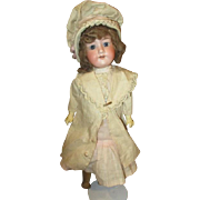 Darling original outfit on Antique doll
