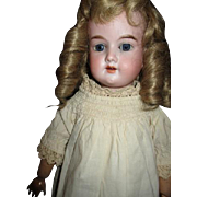 Darling antique bisque doll