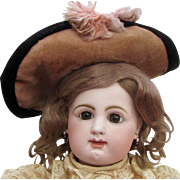 "19"" Rabery and Delphieu, French bisque, amber-eyed, closed-mouth Bebe"