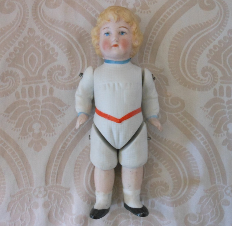 Antique German All Bisque Doll in Molded White Costume
