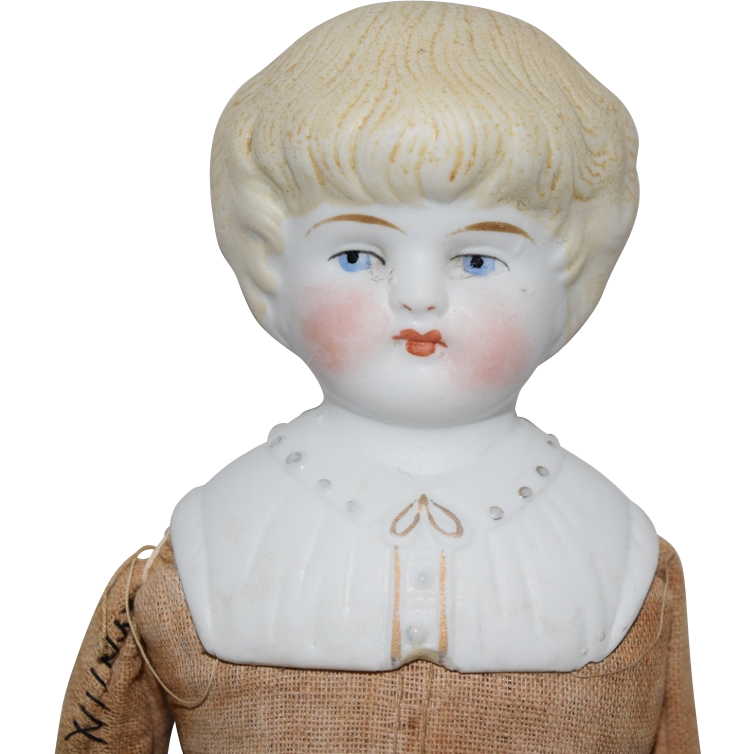 Hertwig German Bisque Head Doll with Decorated Shoulder Plate