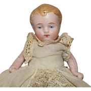 German All Bisque Baby in a Christening Gown
