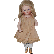 German All Bisque Doll with Round Face and Yellow Boots