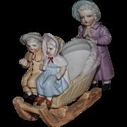Kate Greenaway Style German Bisque Figurine of Three Children