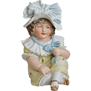 German All Bisque Piano Baby Child with a Blue Bow Hat