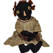 Black Cotton Cloth Doll with Embroidered Features and Button Eyes