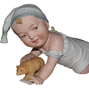 Unusual German Bisque Piano Baby with Bear Toy