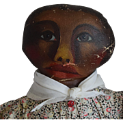 Antique Folk Art Oil Painted Face Black Doll with Emotive Expression