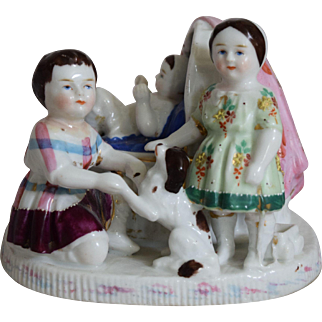 Early German Porcelain Figurine Vignette of Two Children, a Baby, and a Dog