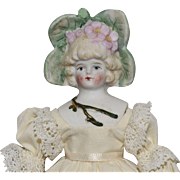 German Bisque Doll with Flower Head Decoration