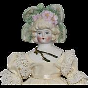 German Bisque Doll with Flower Head Decoration