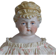 German Glazed Porcelain China Head Doll with Unusual Hairstyle