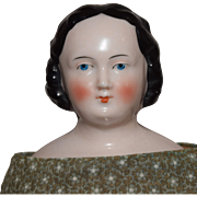 Antique German Pink Tint China Head Doll with Modified Flat Top Hairstyle