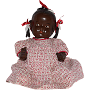 Large Brown Composition Bent Limb Baby