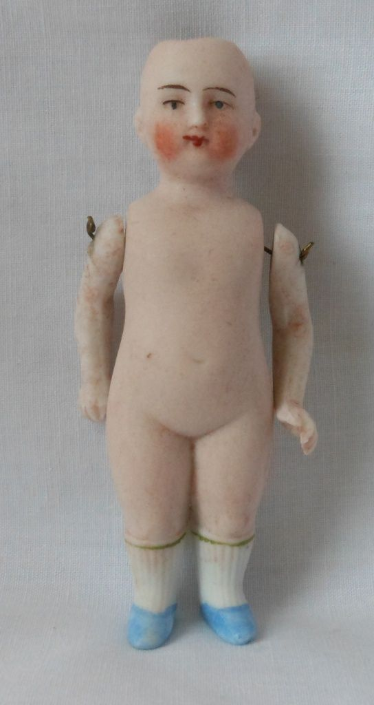 Early All Bisque German Doll with Blue Molded Shoes and Shirred Hose