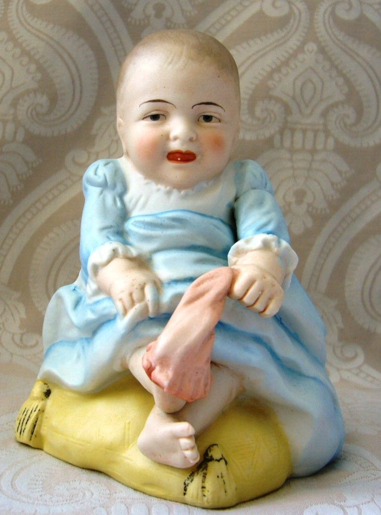 Humorous German Bisque Piano Baby Pulling off Her Sock