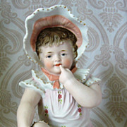 Antique German Bisque Piano Baby with Peach Bonnet