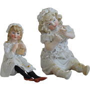 Two Little German All Bisque Girl Figurines
