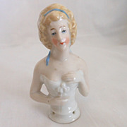German Glazed Porcelain China Half Doll with Blonde Hair and Blue Ribbon