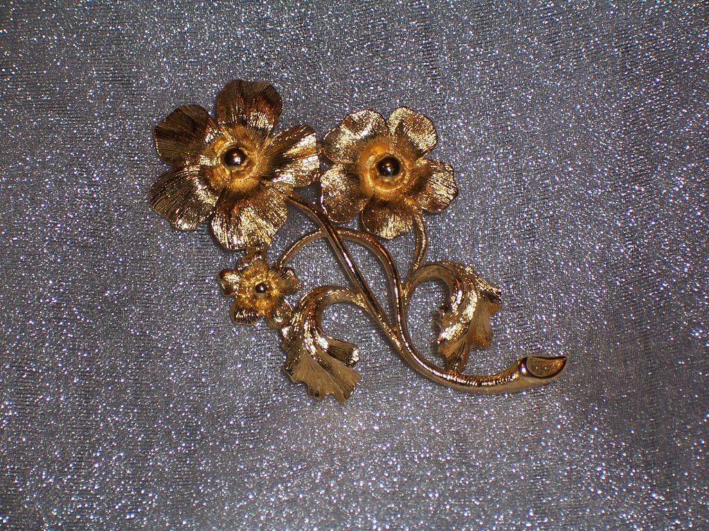 Shiny Signed Monet Gold Tone Textured Floral Brooch